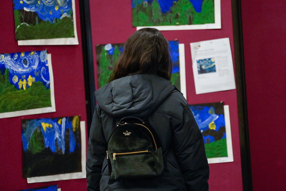 A student looks at art at The Next Big Think