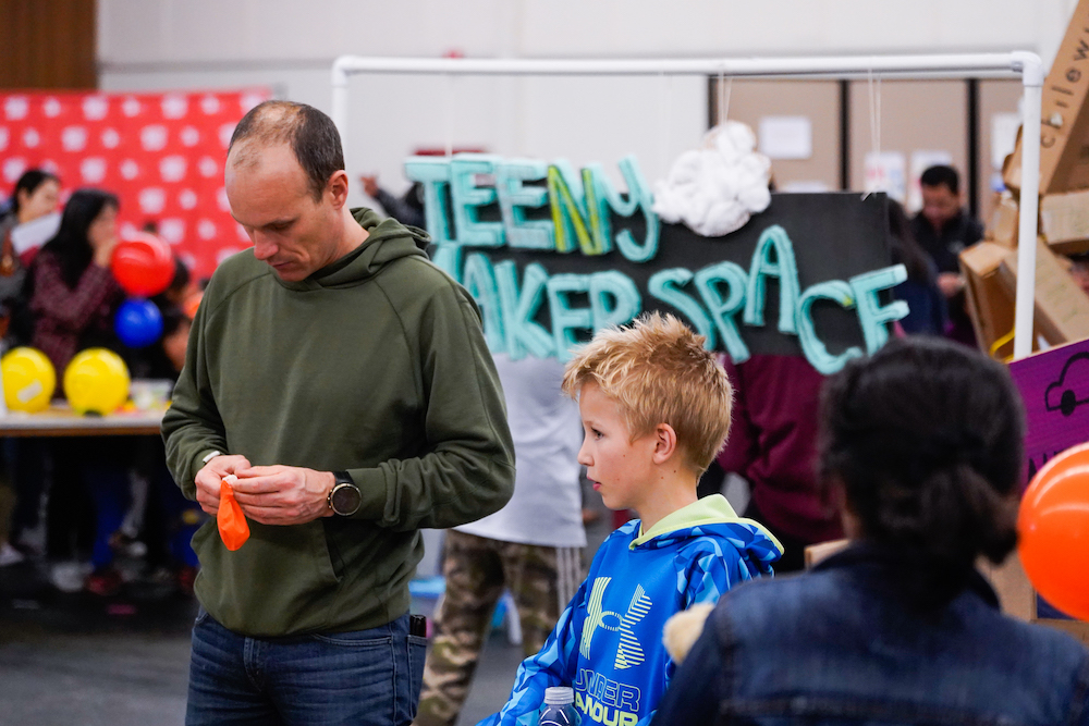 An adult and child visit the Teeny Makerspace  at The Next Big Think