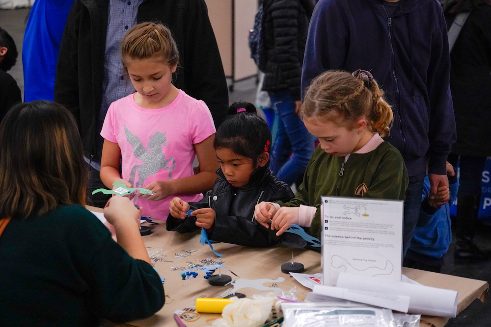 Three young students do arts and crafts at The Next Big Think