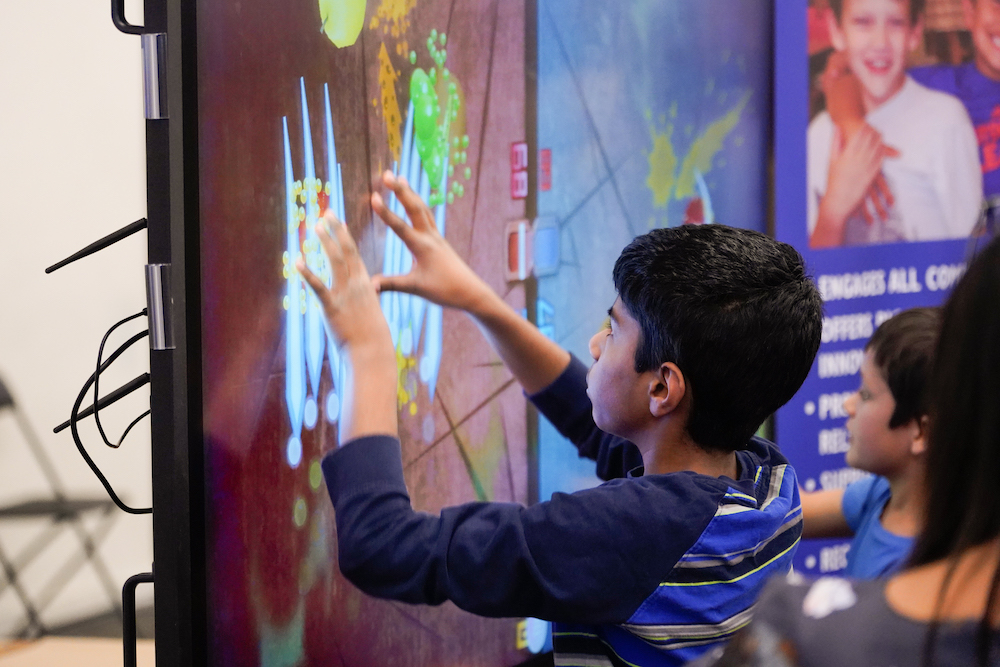 A student plays with an LED display at The Next Big Think