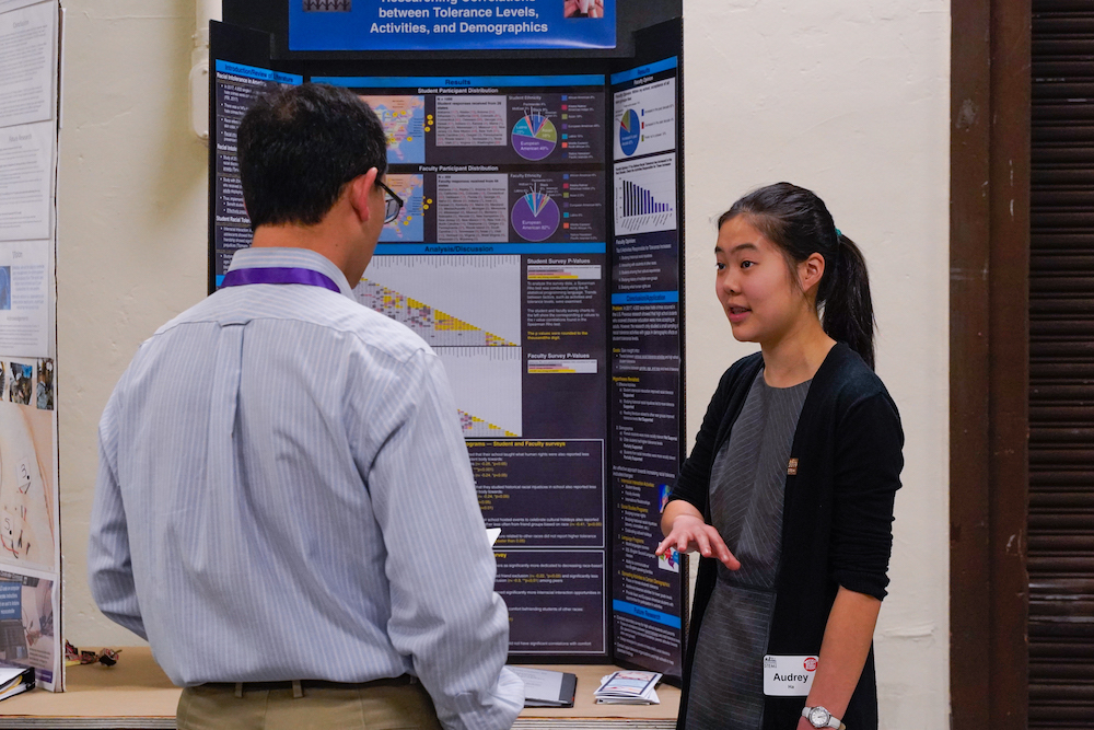 A student shares her STEM Fair project with a judge at The Next Big Think