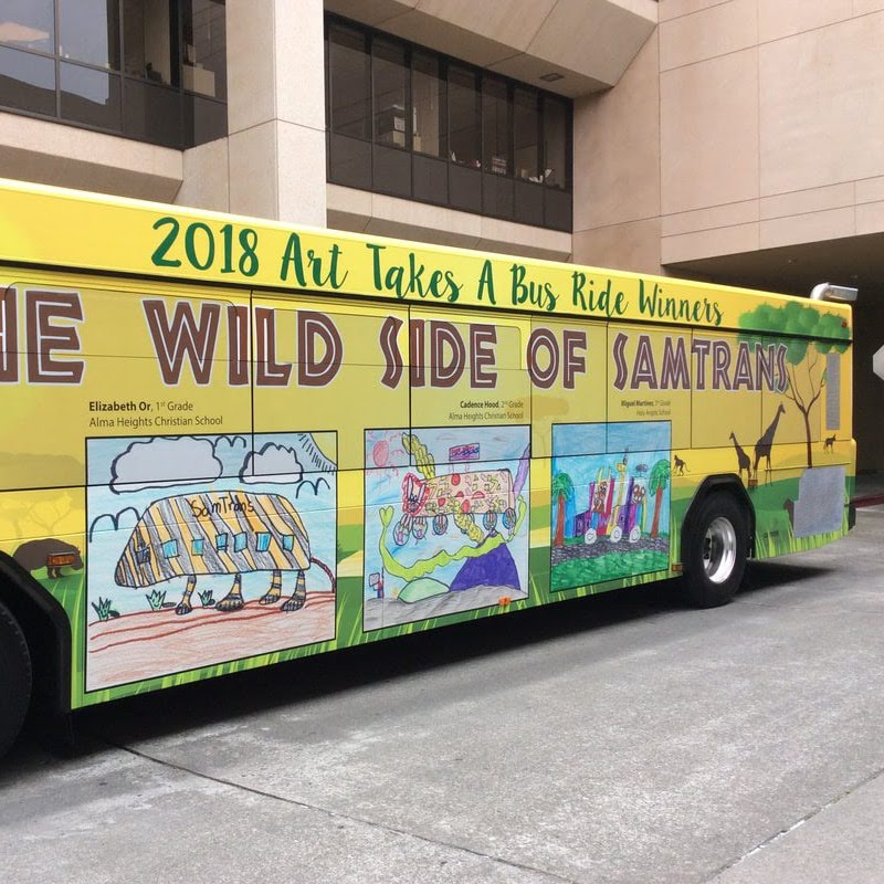 A SamTrans bus displays the 2018 Art Takes a Bus Ride winners.